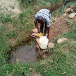 The Water Project: Shihingo Community, Inzuka Spring -  Fetching Water