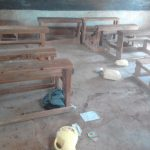The Water Project: Kima Primary School -  Classroom With Some Water Containers On The Floor
