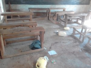 The Water Project:  Classroom With Some Water Containers On The Floor