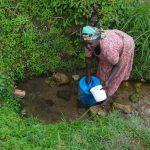 The Water Project: Eshikhugula Community, Shaban Opuka Spring -  Fetching Water