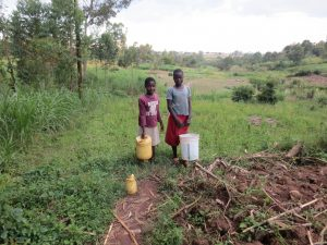 The Water Project:  Children With Water Containers