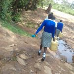 The Water Project: Dr. Gimose Secondary School -  Carrying Water Back To School