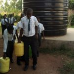 The Water Project: Ebulonga Mixed Secondary School -  Fetching Water From The Plastic Tank