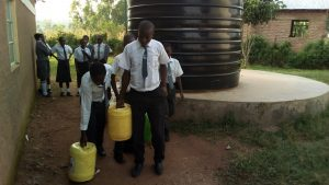The Water Project:  Fetching Water From The Plastic Tank