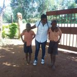 The Water Project: Mukoyani Primary School -  Field Officer Jacky Posing With Students