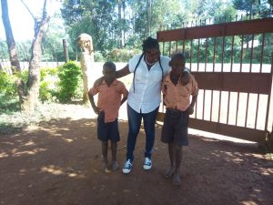 The Water Project:  Field Officer Jacky Posing With Students