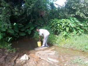 The Water Project:  Benjamin Sachita Fetching Water