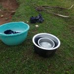 The Water Project: Eshikhugula Community, Shaban Opuka Spring -  Spring Water Being Used For Laundry