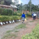 The Water Project: Dr. Gimose Secondary School -  Carrying Water Back