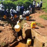 The Water Project: Ikumba Secondary School -  Waiting For Community Member To Finish