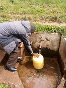 The Water Project:  Community Spring Where Students Fetch Water Between Class