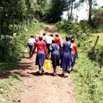 The Water Project: Goibei Primary School -  Carrying Water Back To School