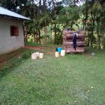 The Water Project: Bung'onye Community, Shilangu Spring -  Water Containers By Bathing Shelter
