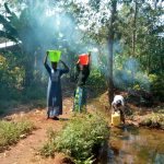 The Water Project: Lutonyi Community, Lutomia Spring -  Fetching Water