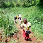 The Water Project: Mushina Community, Shikuku Spring -  Carrying Water Up The Hill