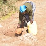 The Water Project: Mukuku Community -  At The Scoop Hole
