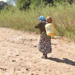The Water Project: Mukuku Community -  Carrying Water Home