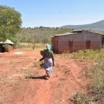 The Water Project: Mukuku Community -  Returning Home With Water Jug