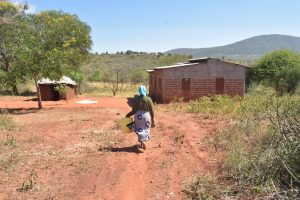 The Water Project:  Returning Home With Water Jug