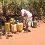 The Water Project: Kaukuswi Community -  Arranging Water Containers