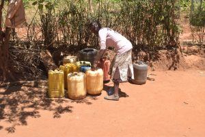 The Water Project:  Arranging Water Containers