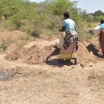 The Water Project: Kaukuswi Community -  Dumping Sand For Mixing With Cement