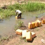 The Water Project: Kaukuswi Community -  Filling Containers With Water