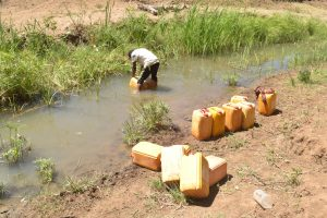 The Water Project:  Filling Containers With Water