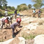 The Water Project: Kaukuswi Community -  Preparing Area For Dam And Well