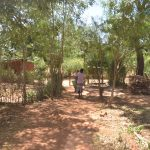 The Water Project: Kaukuswi Community -  Walking In Compound