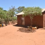 The Water Project: Kaukuswi Community -  Water Storage Containers In The Compound