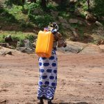 The Water Project: Maluvyu Community G -  Carrying Water