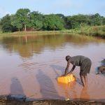 The Water Project: Kangalu Community A -  Fetching Water