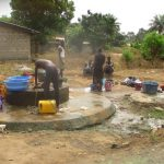 The Water Project: Tholmossor, Masjid Mustaqeem, 18 Kamtuck Street -  Community Members At Nearby Open Well