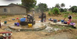 The Water Project:  Community Members At Nearby Open Well