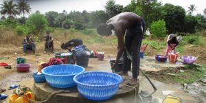 The Water Project:  Fetching Water From Open Well