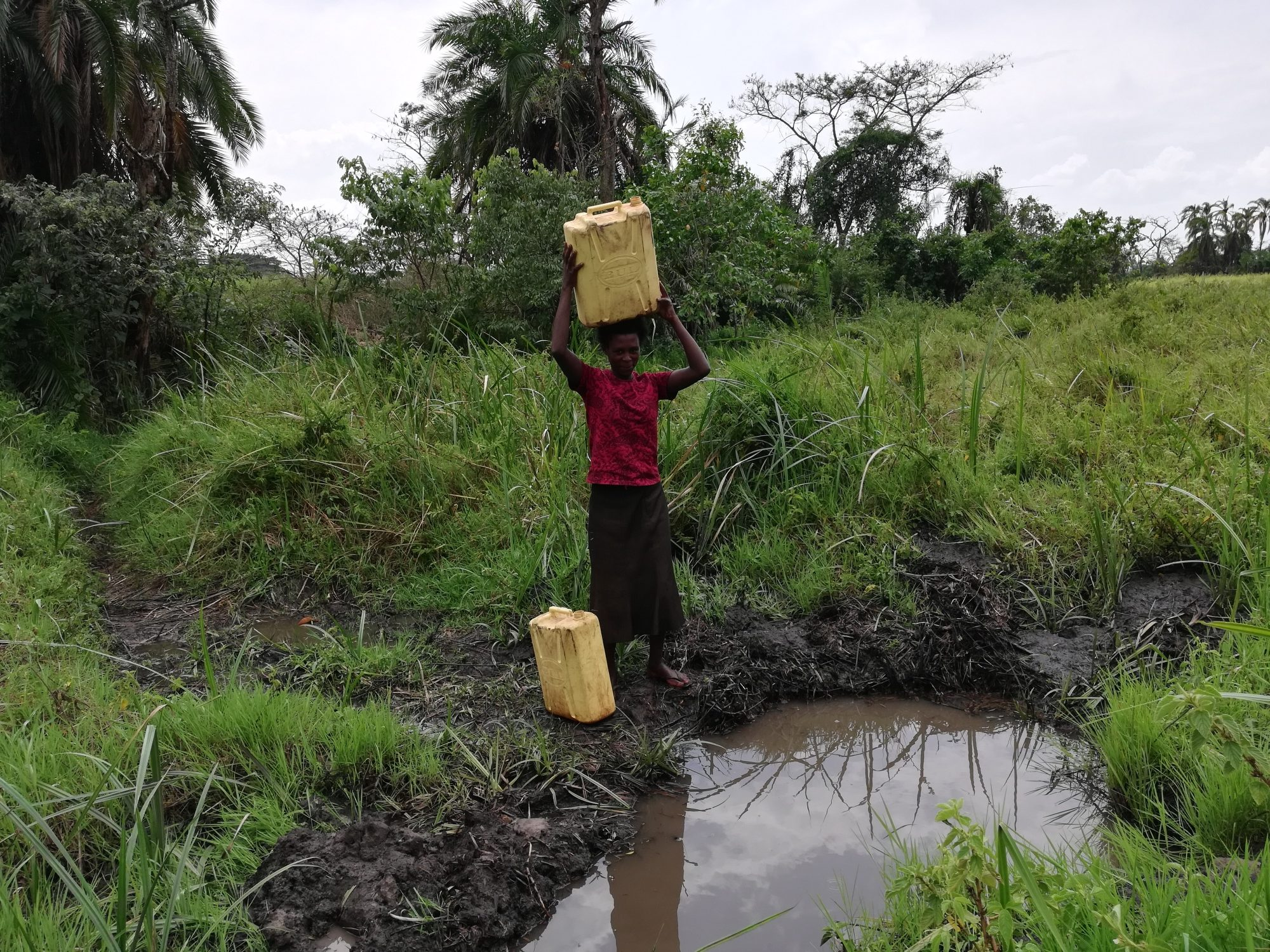 The Water Project : uganda19280-carrying-water