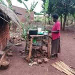 The Water Project: Nyakasenyi Byebega Community -  Placing Dishes On Rack