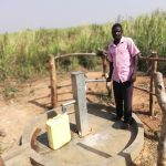 The Water Project: Kimigi Kyamatama Community -  At Distant Well