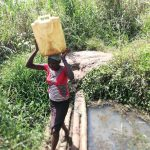 The Water Project: Kimigi Kyamatama Community -  Carrying Water From Open Source