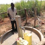 The Water Project: Kimigi Kyamatama Community -  Collecting Water