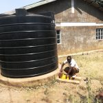 The Water Project: Kimigi Kyamatama Community -  Collecting Water From Rainwater Tank