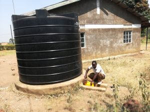 The Water Project:  Collecting Water From Rainwater Tank