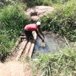 The Water Project: Kimigi Kyamatama Community -  Fetching Water