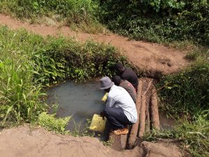 The Water Project:  Katusabe Gerald Fetching Water From The Open Well