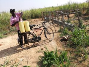 The Water Project:  Loading Water Containers Onto Bike