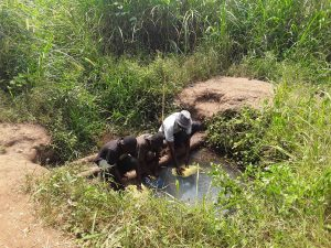 The Water Project:  Mr Katusabe Gerald Fetching Water From The Open Well