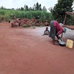 The Water Project: Kikube Nyabubale Community -  Cleaning Pots