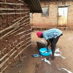 The Water Project: Kikube Nyabubale Community -  Washing Clothes