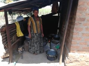 The Water Project:  A Woman Cooking In The Kitchen